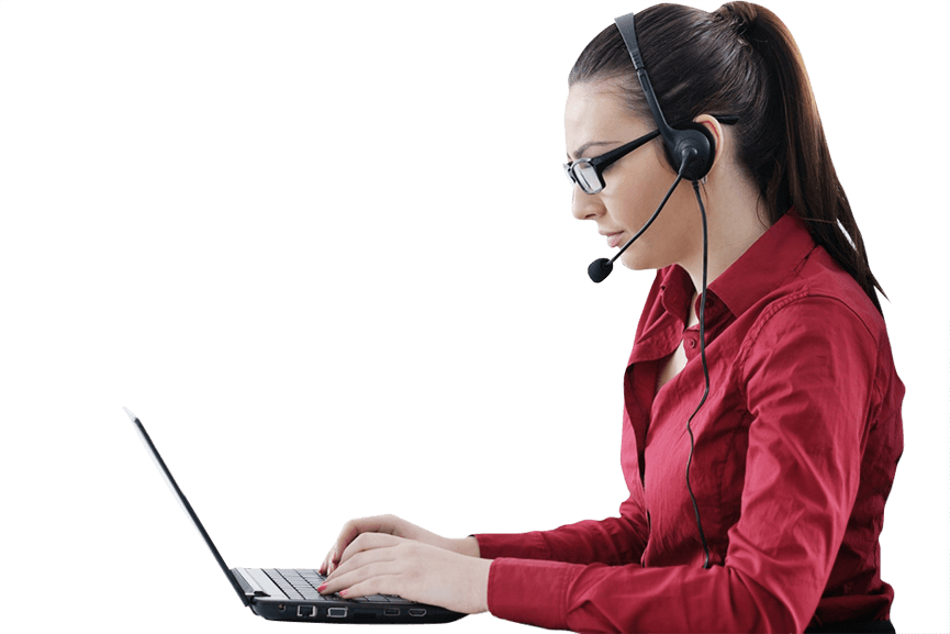 Millennial woman with brown hair and glasses wearing a red shirt and call center headset looking down at a laptop